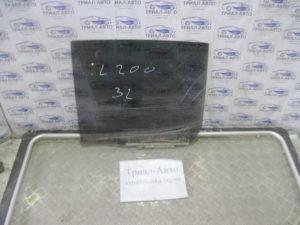 Стекло боковое заднее левое  5736A007 на L200 2006-2012 г.в.