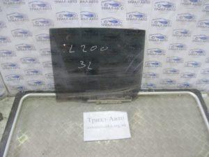 Стекло боковое заднее левое L200 2006-2012