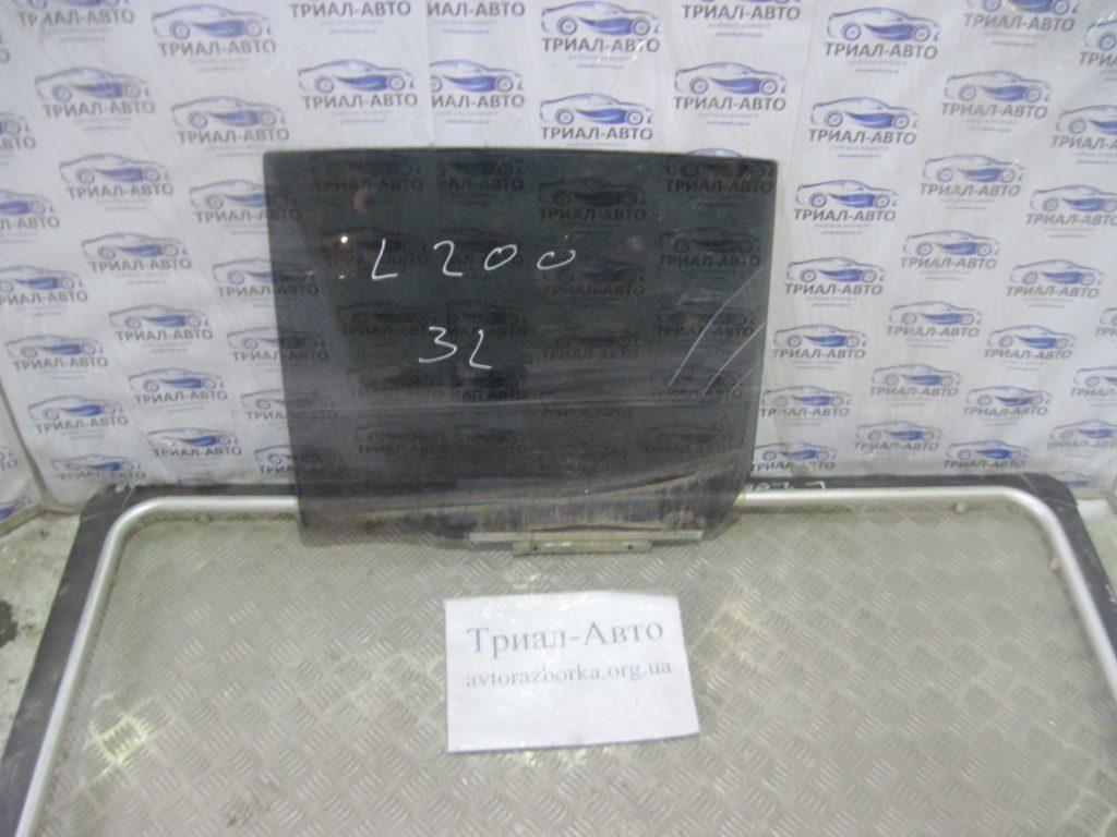 стекло боковое заднее левое L200 2006-2013